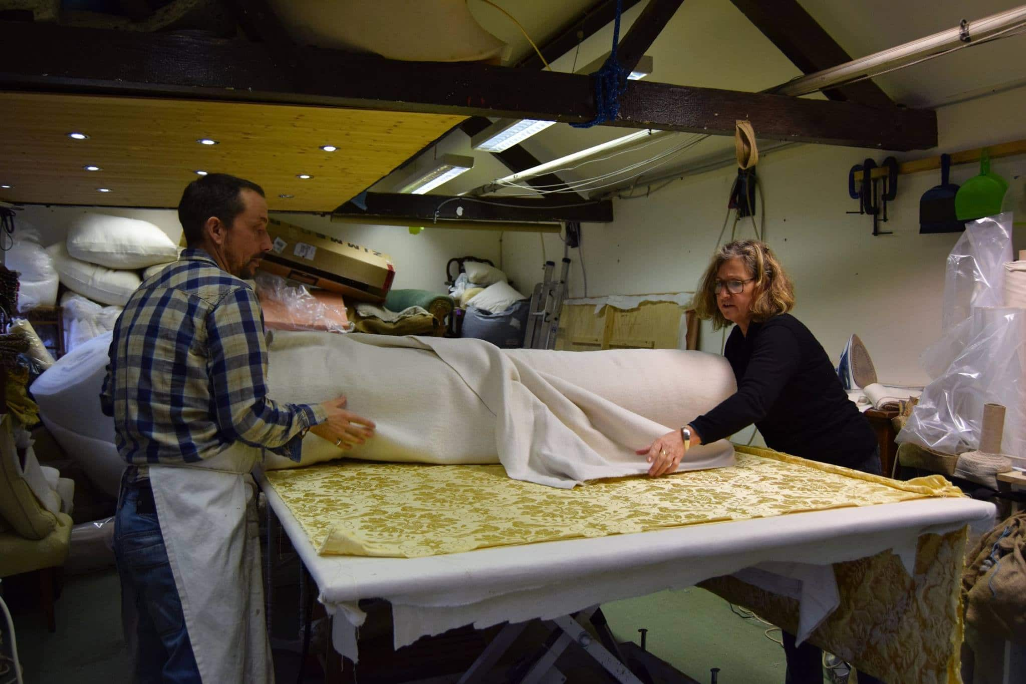unrolling new roll of fabric
